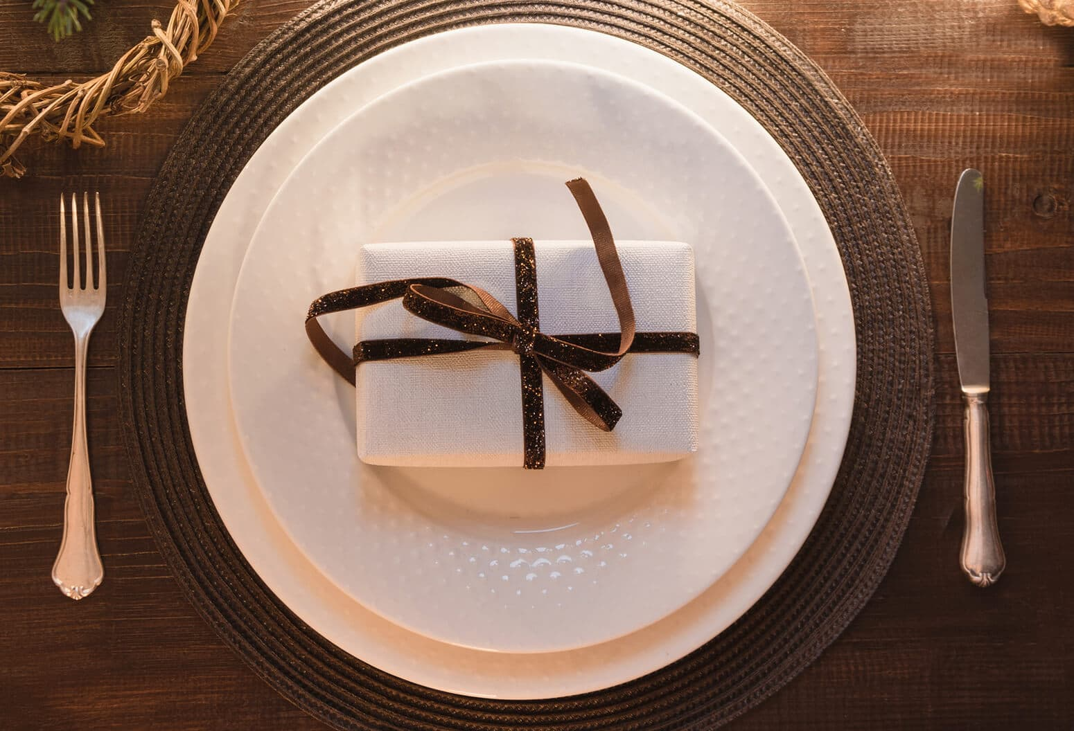 White and Brown table setting with gift box at Houndstooth Restaurant
