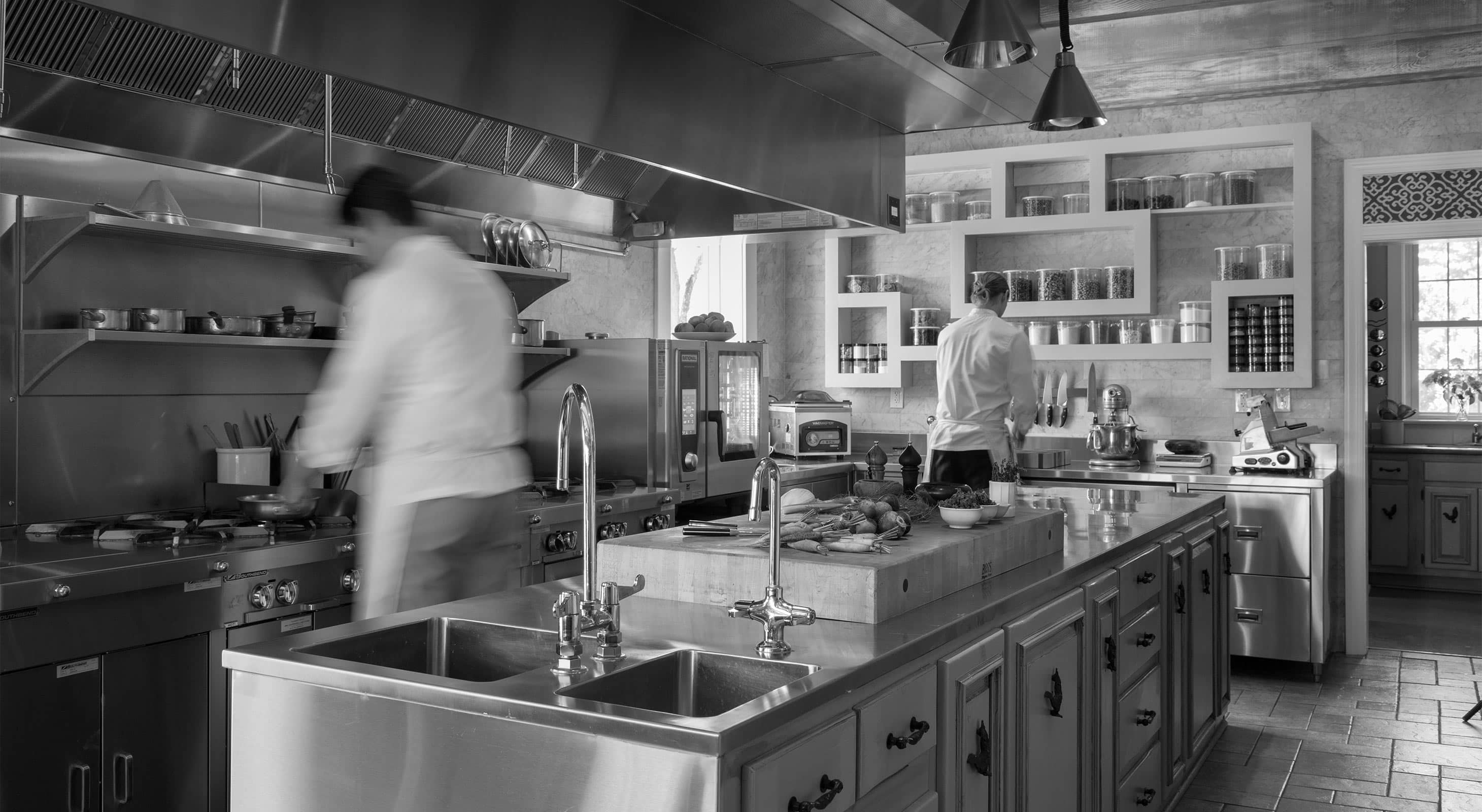 Chefs in Kitchen with veggies on kitchen island