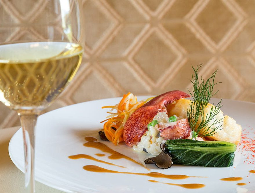 Lobster entree with glass of white wine