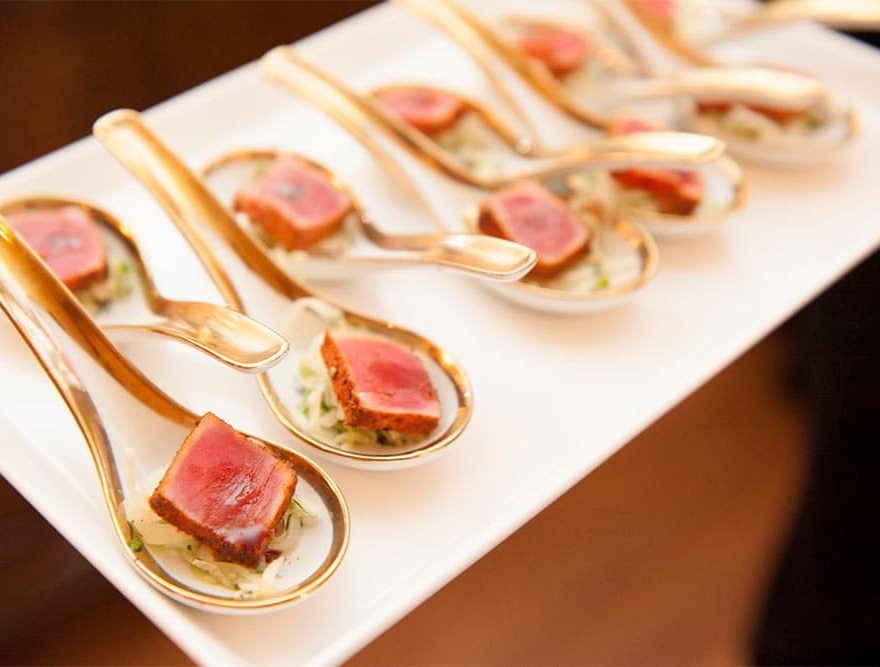 Passed hors d'oeuvres tray with spoons including meat