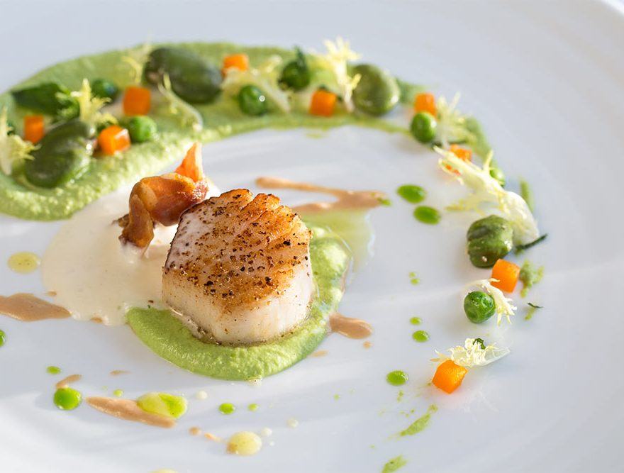 Sea Scallops on plate with peas and carrots